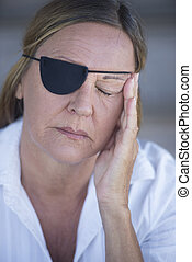 Exhausted woman with eye patch portrait - Portrait tired...