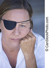 Depressed woman with eye patch portrait - Portrait sad...