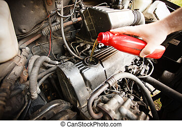 Motor oil, car engine close up - Car servicing mechanic...