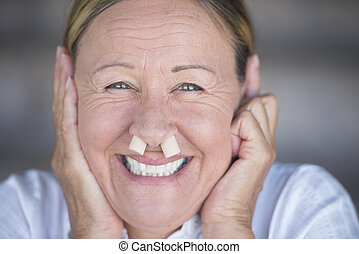 Happy smiling woman with nose plugs portrait