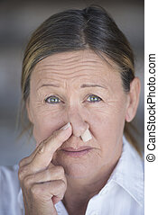 Stressed woman with nose plug