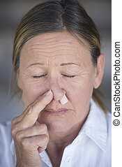 Woman closed eyes and protective nose plug