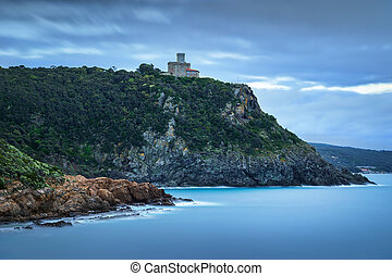 Cliff rock and building on the sea on winter. Quercianella,...