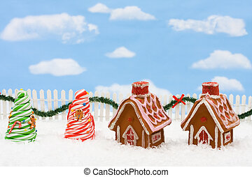 Gingerbread House - Gingerbread house on snow with a white...