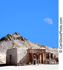 Abandoned Building - Old style western adobe building moon...
