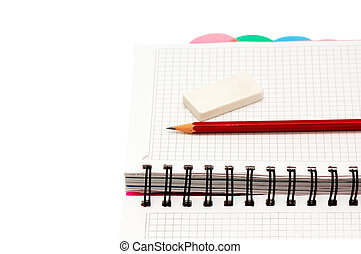 notebook, pencil, eraser isolated on a white background...