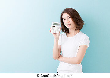 electronic calculator - young attractive asian woman having...