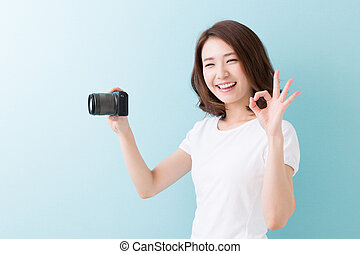 woman who takes a photograph - young attractive asian woman...
