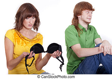 man cheat - surprised woman holding bra from another girl