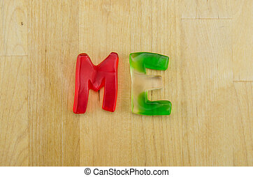 Gummy Words Me - Multi colored gummy letters spell the word...