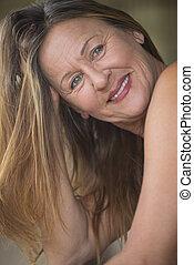 Confident attractive mature woman posing - Portrait...