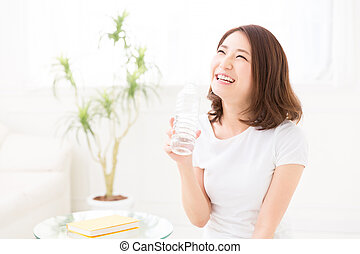 woman who drinks water - young attractive asian woman who...