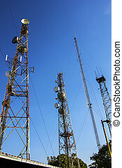 Telecommunication mast with microwave link and TV