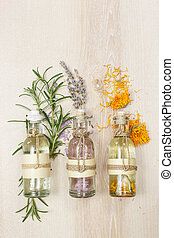 Aromatherapy massage oils - Row of essential oils in glass...
