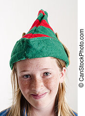 elf hat on girl - Young girl wearing green elfs hat with big...