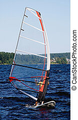 windsurfer on a board with plastic transparent sail