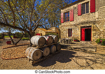 Wine barrels in the background of an ancient house. France....