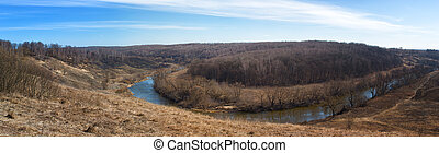 Spring landscape with the river and the blue sky.Panorama