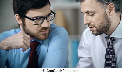 Formal Discussion - Close up of two men discussing business