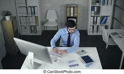 Love your Job - High angle view of businessman computing in...