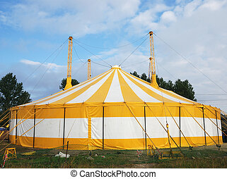 circus tent - yellow and white circus tent outdoor in summer