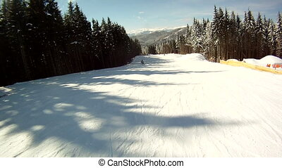 Skier rides on the ski slopes. First-person view.
