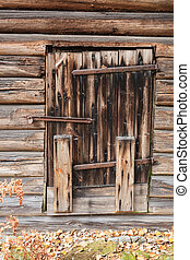 Old wooden barn door - Closed old wooden barn door