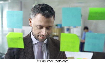 Post It - Close up of smart businessman removing memory...