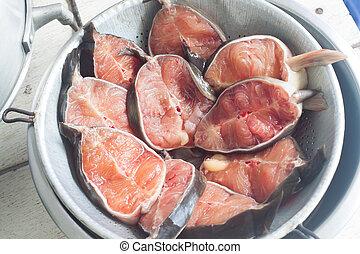 Fresh raw catfish on sieve, close-up - Fresh raw catfish on...