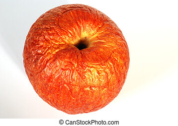 apple - contracted red dry apple against white background