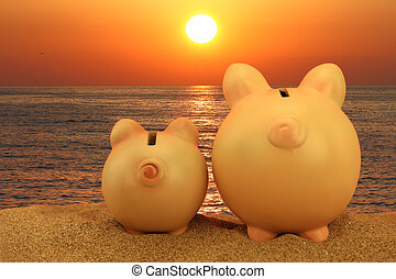 Two piggy banks on the beach looking to the sunset
