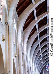 Arches on Stone Wall - View toward the altar in a church...