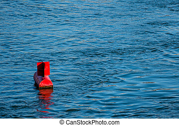 red buoy water surface, symbol of navigation, security,...