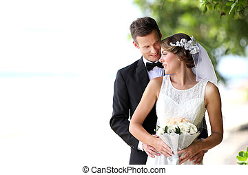 beautiful bride and handsome groom happy together - portrait...
