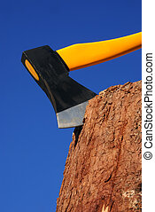 ax - heavy ax put in stump against blue sky...