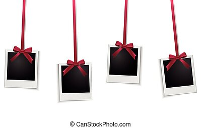 Photo frames hanging on red ribbon