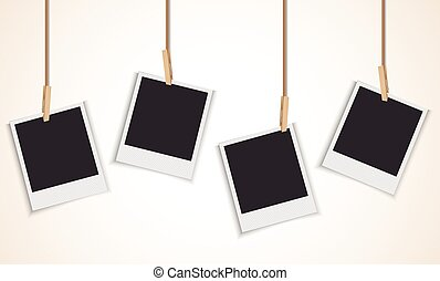 Blank photo frame hanging on rope