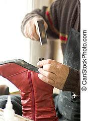 cobbler - one cobbler working in his shop