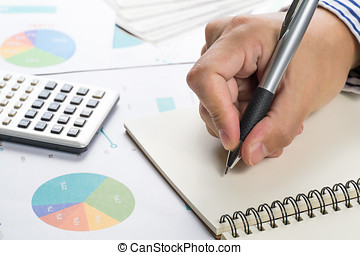 Man writing idea for Analysis Business and financial report