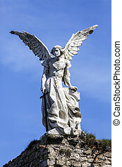 Sculpture of a Guardian angel with a sword in the cemetery...