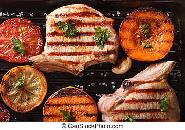Grilled pork and pumpkin on a grill top view horizontal...