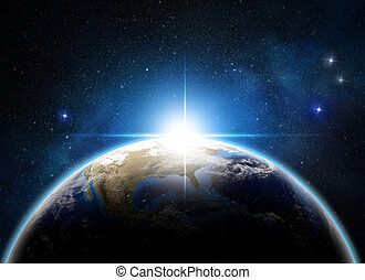a new dawn - sunrise over the earth in outer space