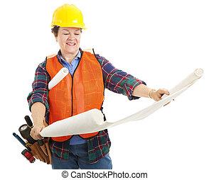 Female Contractor Examines Blueprint