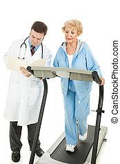 Senior Woman - Monitored Exercise - Senior woman exercising...