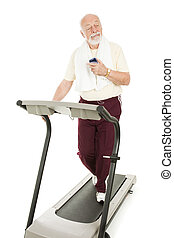 Exercising with MP3 Player - Senior man enjoys music on his...