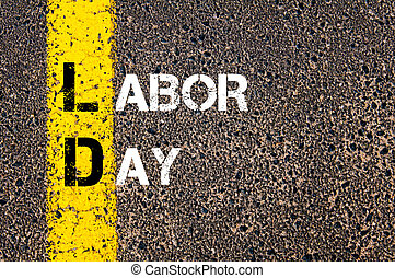Acronym LD as LABOR DAY Yellow paint line on the road...