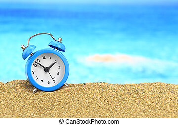Vacation time Alarm clock on the sand