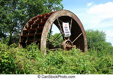 Abandoned water wheel wind turbines sign - An abandoned...
