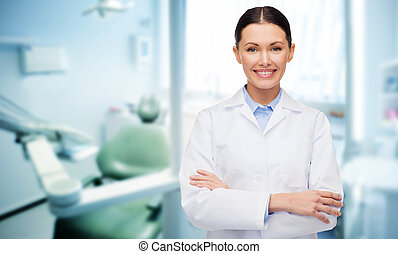 happy young female dentist with tools - people, medicine,...