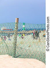 Windbreak Fence at the Beach - Beach life at a sunny day...